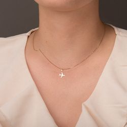 pingente-ouro-18k-aviao-liso-pi21476-joiasgold